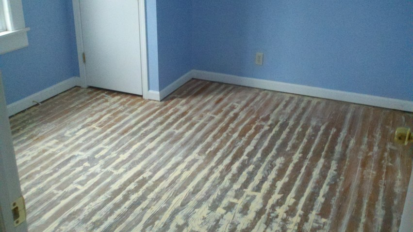 Scratched up and scuffed wood floor
