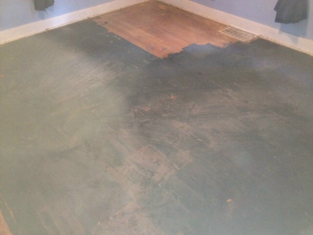 A damaged and beat up wood floor