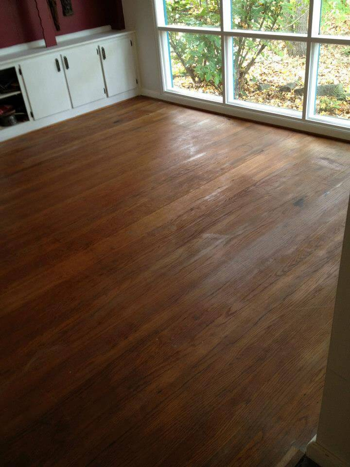 A clearly damaged wood floor surface