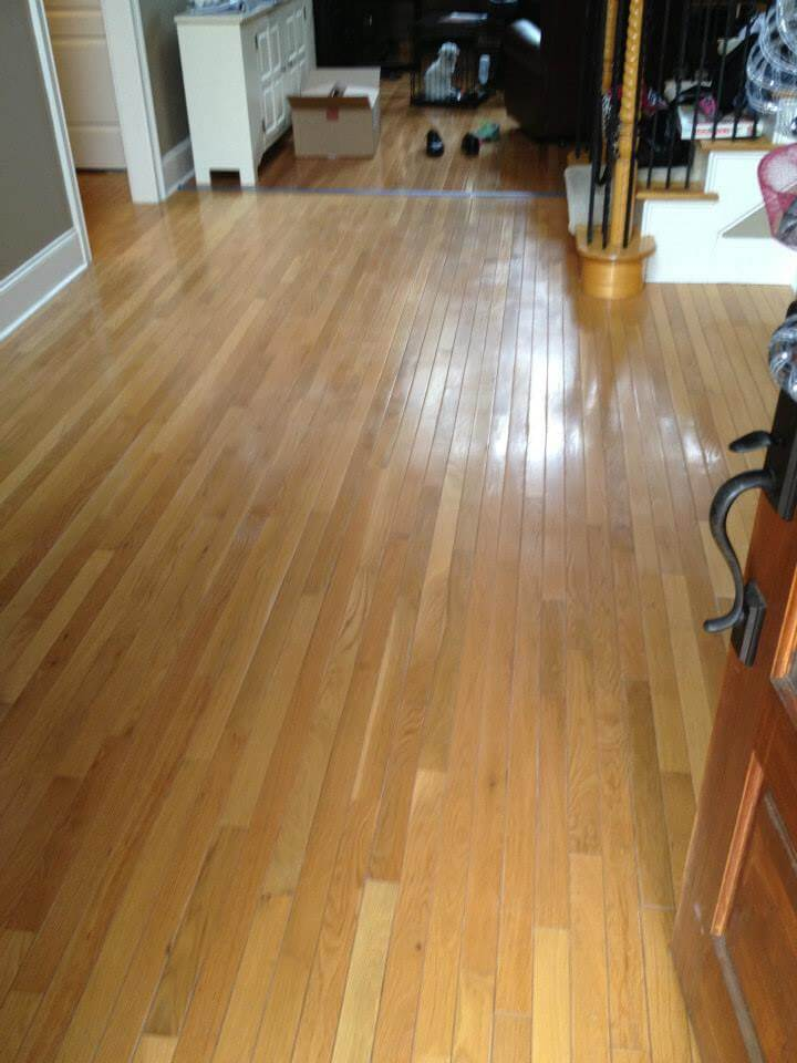 a damaged engineered wood floor