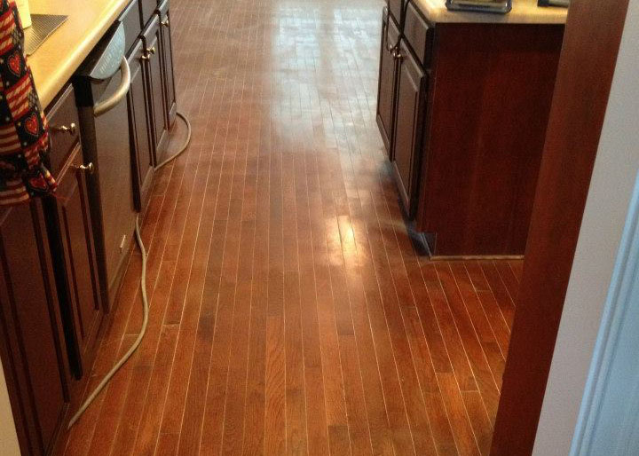 A before shot of a scratched up wood floor in Orange County.